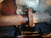 With a 13mm socket, remove the nuts at the catalytic converter flange